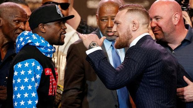 Floyd Mayweather and Conor McGregor facing off during a press conference