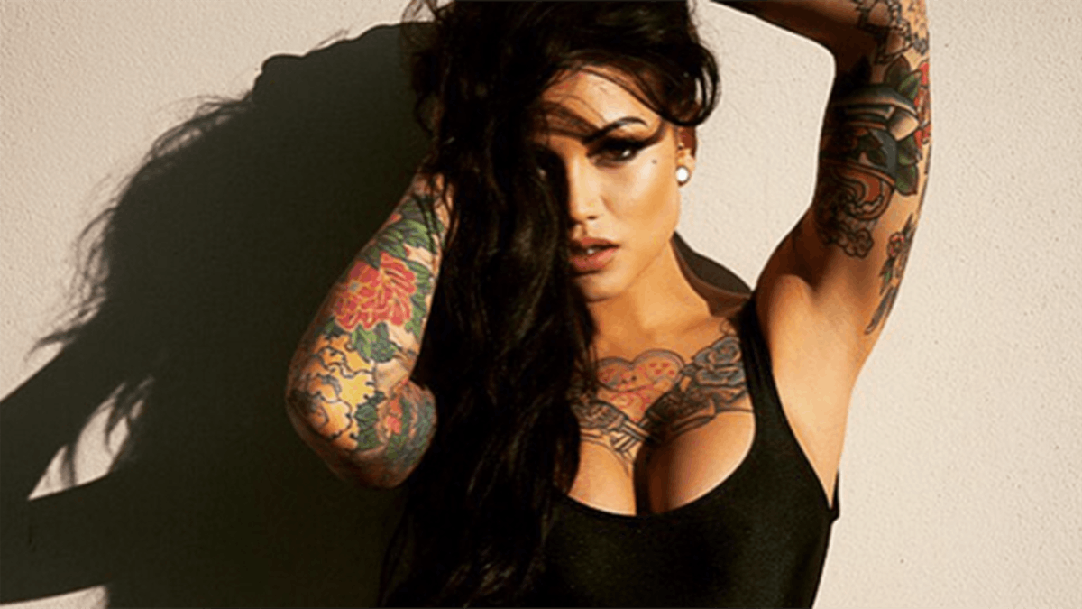 A women covered in tattoos posing