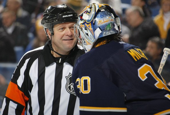 An NHL Official talking to a player during the game