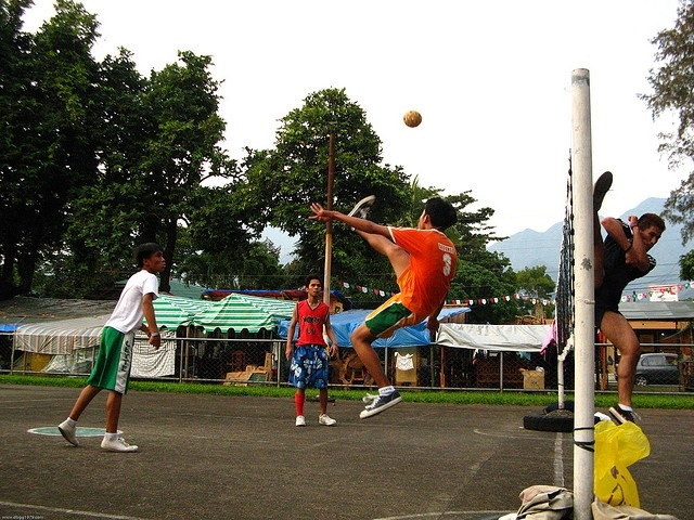Players playing Sepak Takraw on an outdoor court