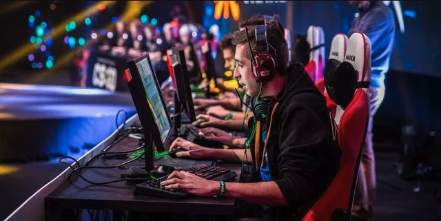 Professional players competing in an Overwatch tournament