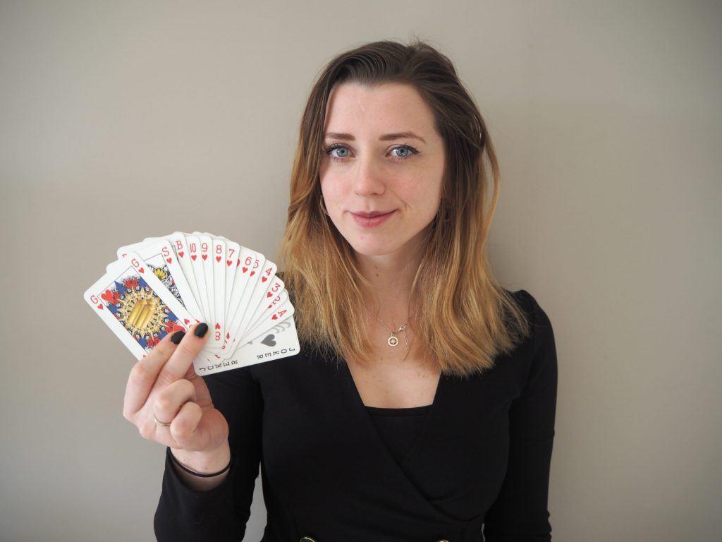 Indy Mellink holding her GSB cards