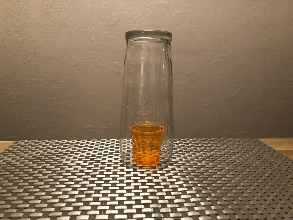 Shot glass covered by pint glass