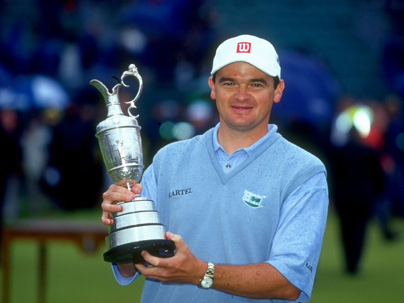 Scottish-born Paul Lawrie posing with The Open trophy