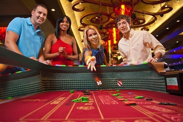 People playing craps at a casino