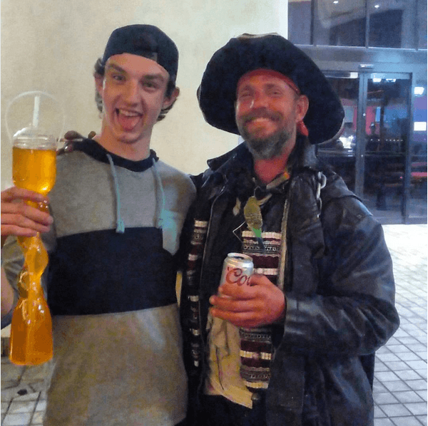 A drunken guy taking a picture with a Pirate impersonator