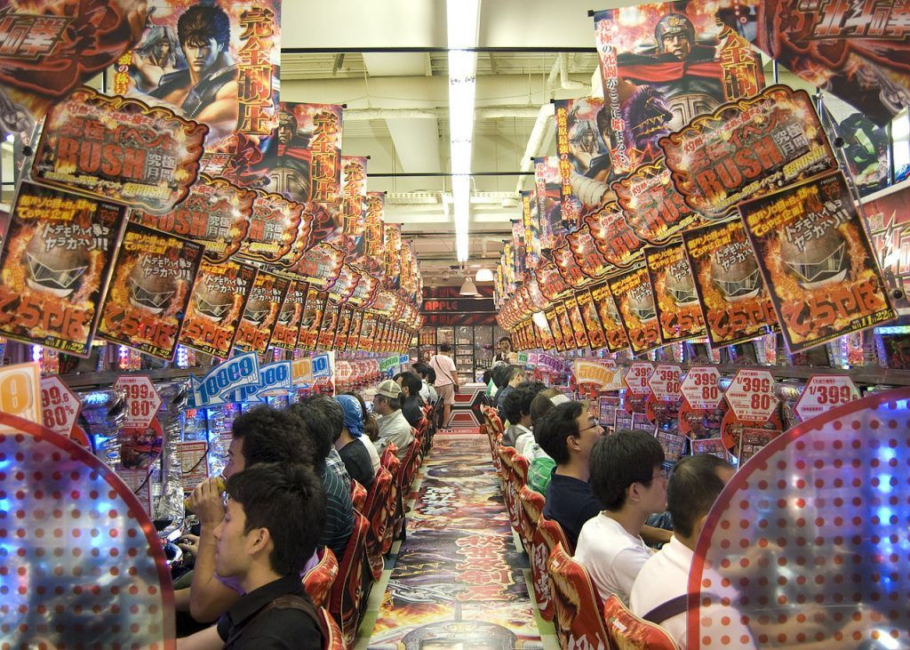photo showing players inside a pachinko parlor playing on machines