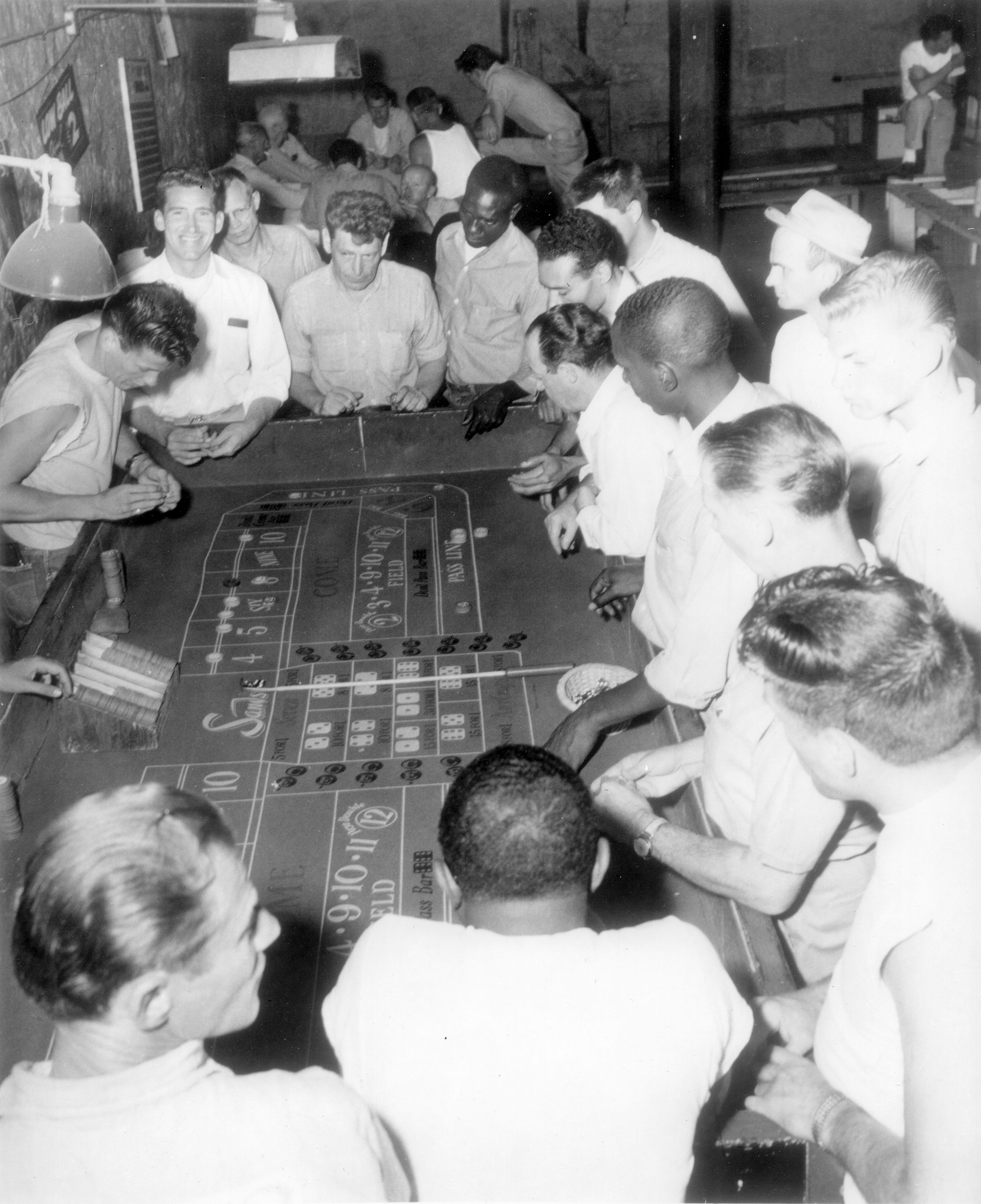 Prisoners enjoying a table game from the in-house casino