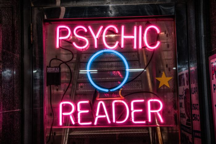 A neon sigh advertising a psychic reader
