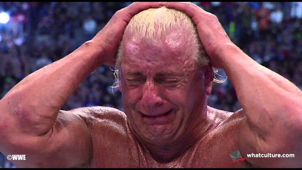 A photo of Ric Flair crying in a WWE ring