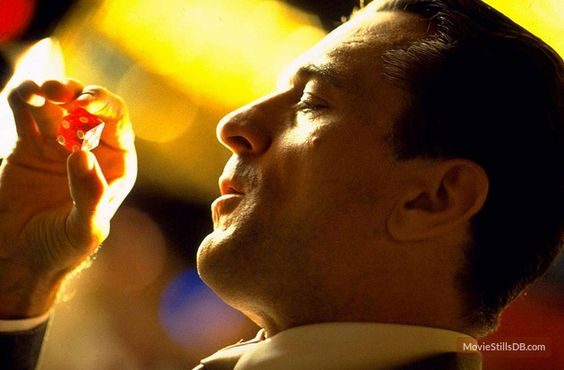 Robert De Niro in Casino movie close up looking at red dice