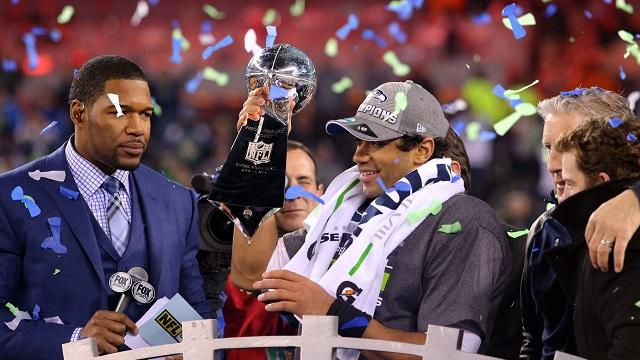 Russell Wilson of the Seattle Seahawks lifting the Vince Lombardi trophy