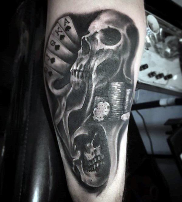 Skull and playing cards gambling tattoo