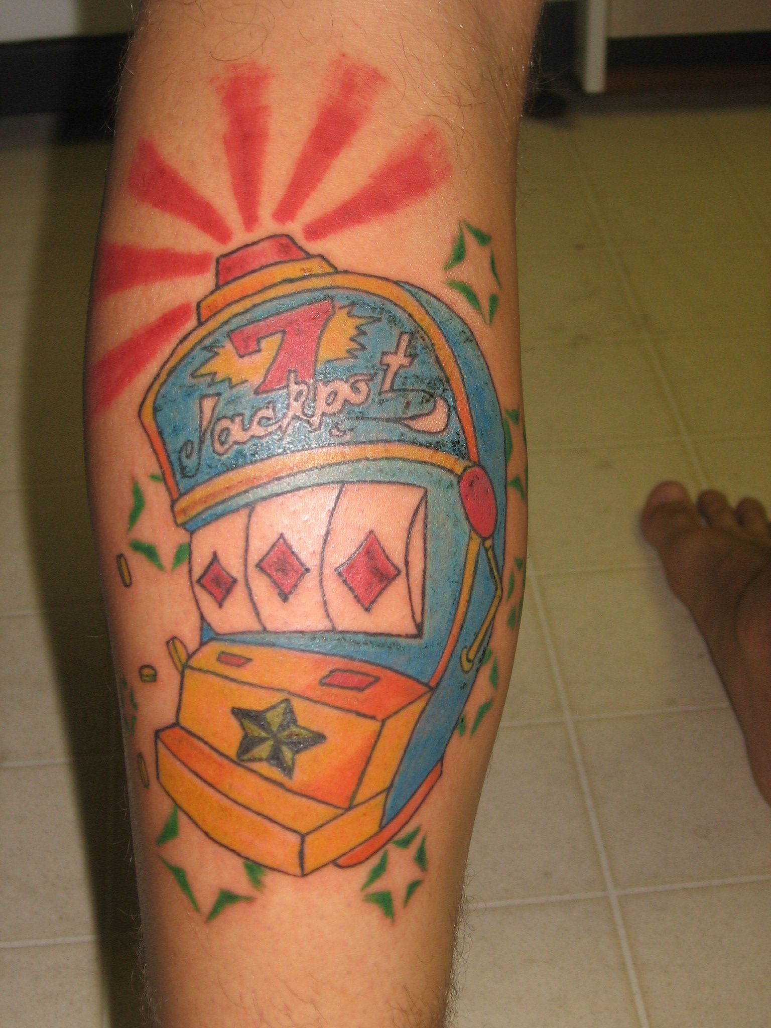 Slot machine leg tattoo