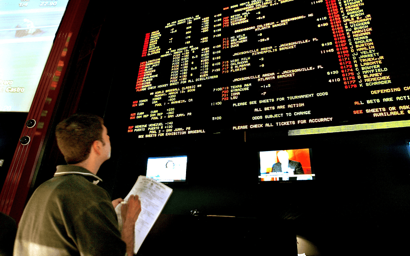 Sports betting board showing the latest odds