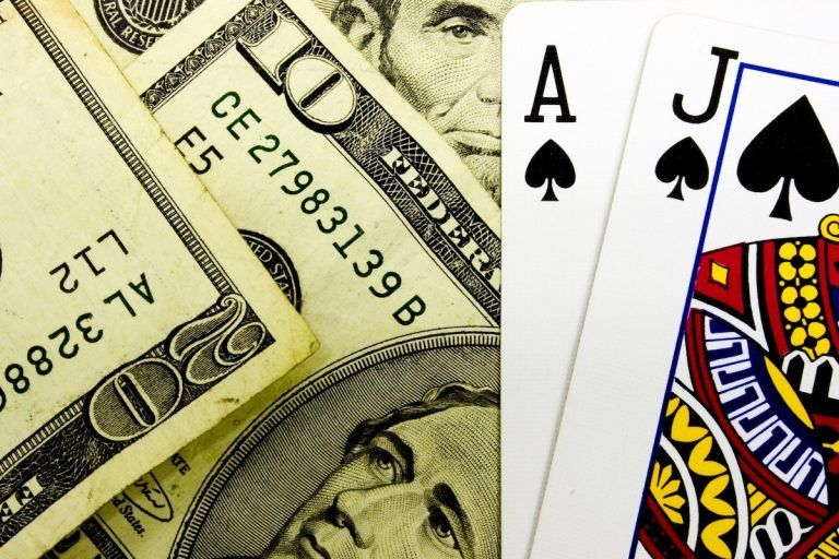 An image showing American dollars and playing cards