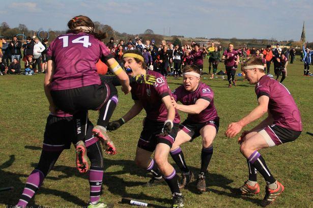 A quidditch team celebrating a game win