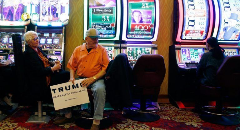 Trump supporter holds sign sitting in casino