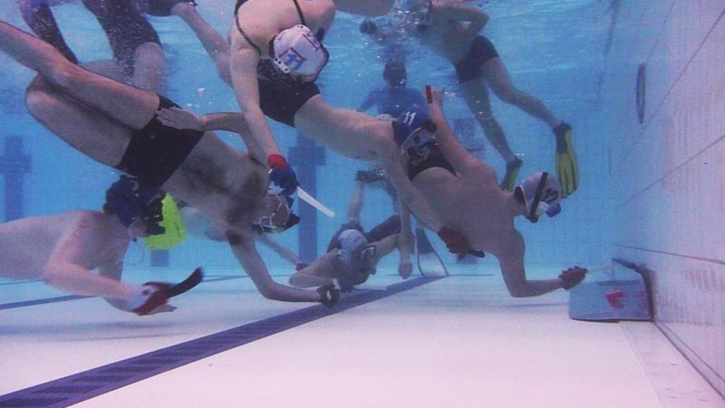 Players competing in Underwater Hockey