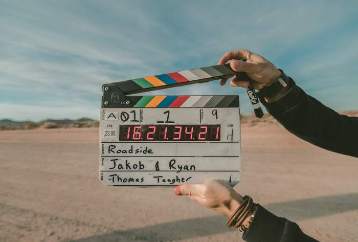 A clapperboard signalling the next scene of a film/tv show