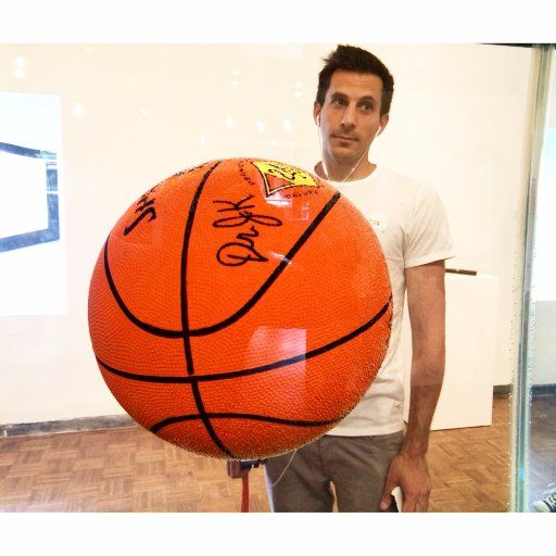 Voulgaris pictured with a signed NBA ball