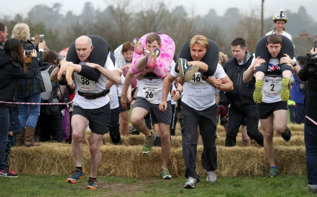 Husbands competing in Wife Carrying