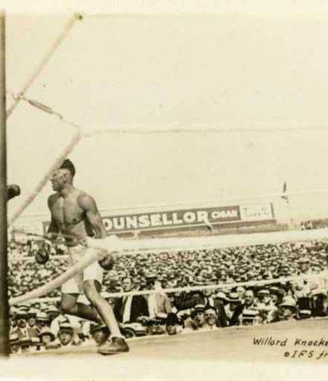 Willard Knocked to the ropes by Jack Dempsey