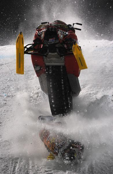 A photo of a snowmobile backflip fail from the Winter X Games