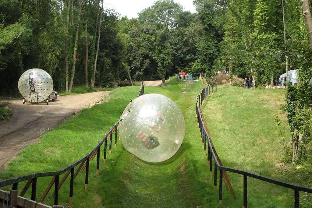 Thrill seekers enjoying a Zorbing course