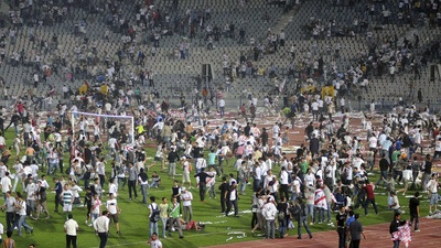 Al Masry fans storming the pitch during a game