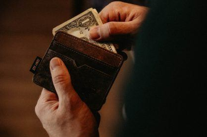 Person getting money out of wallet