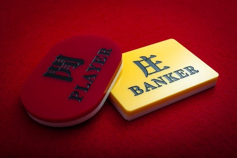 Player or banker are the two options in baccarat, solid red background