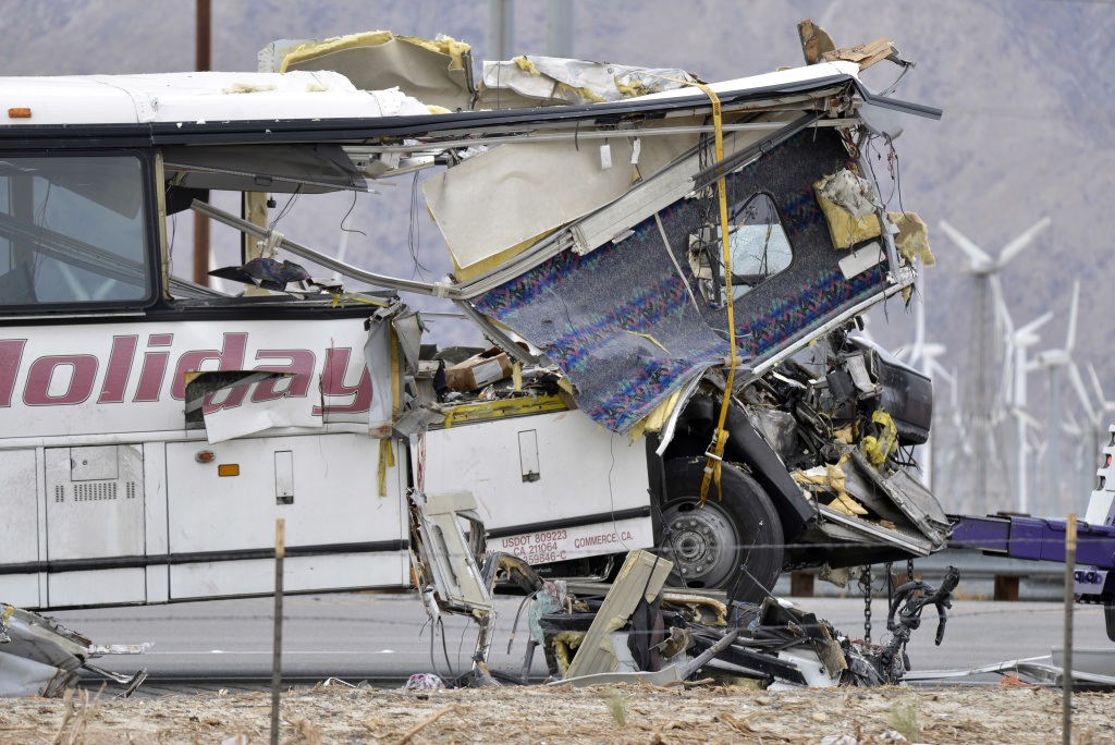 burnt out casino bus after crash
