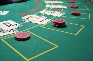 Image: 'Blackjack board' is licensed under Wikimedia Commons