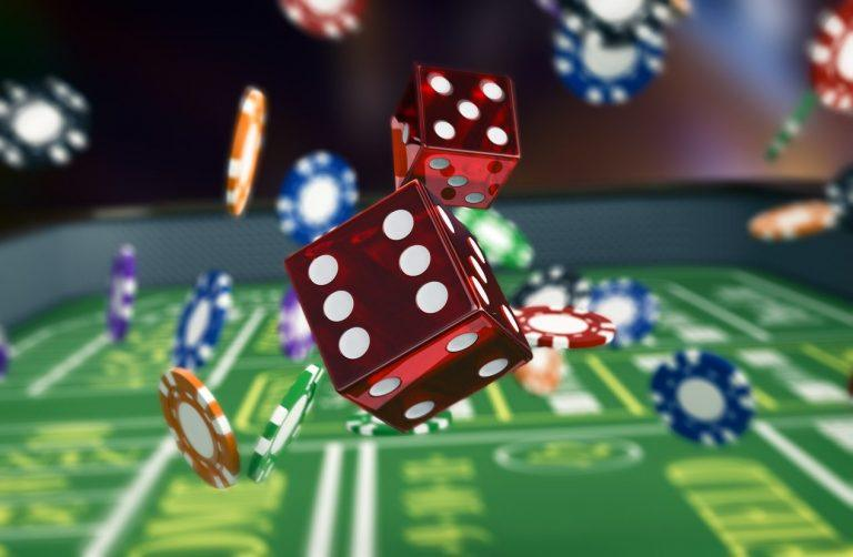 Chips and dice on a craps table background