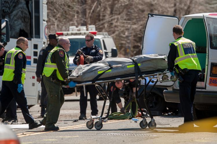 paramedics carry victim of casino bus crash