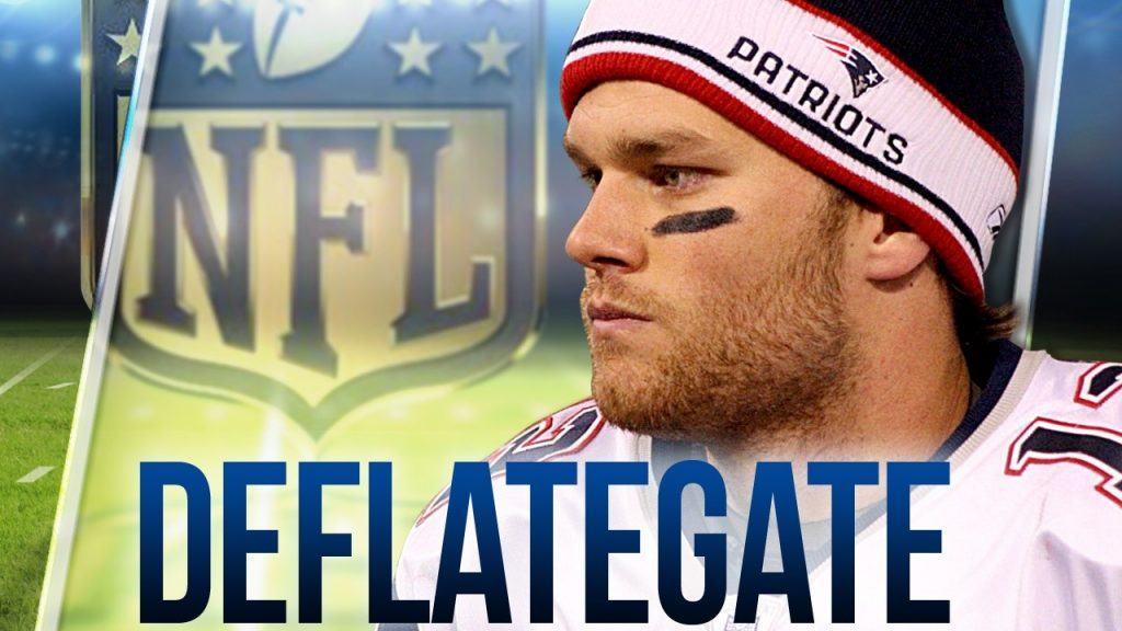 Tom Brady with deflategate text