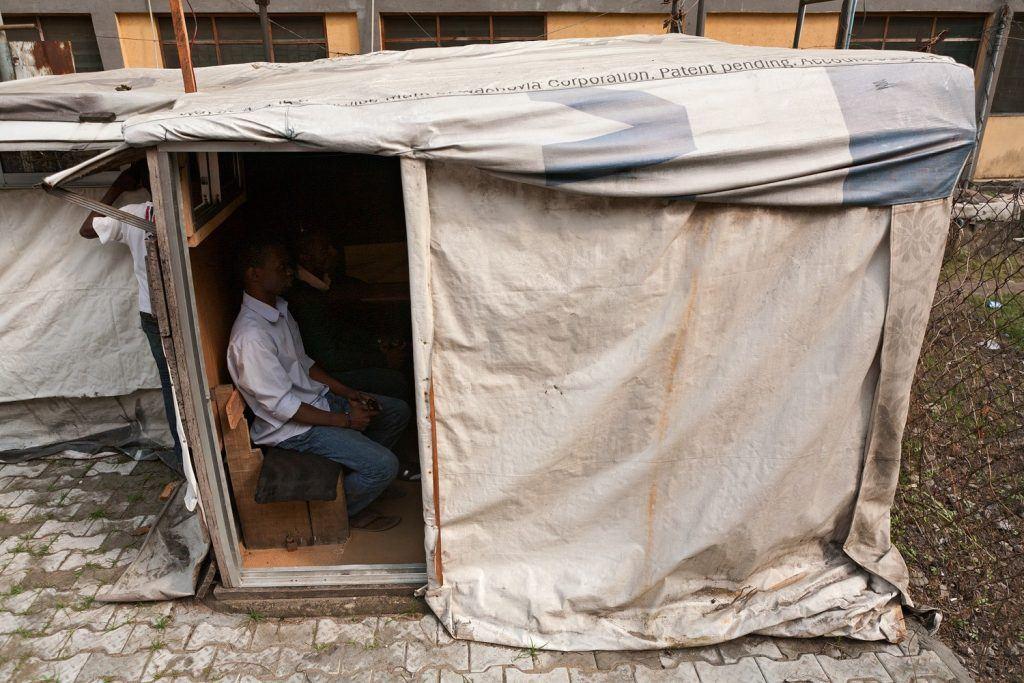 man in hut playing game in Nigeria