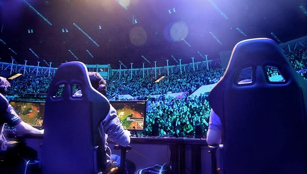 professional esports players playing in front of fans