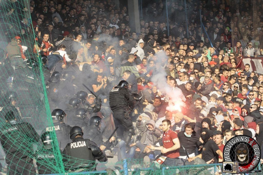 FK Sarajevo fans clashing with riot police during a game