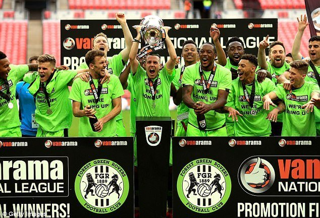 forest green rovers football team winning holding trophy