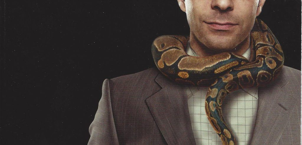 psychopath at work with snake