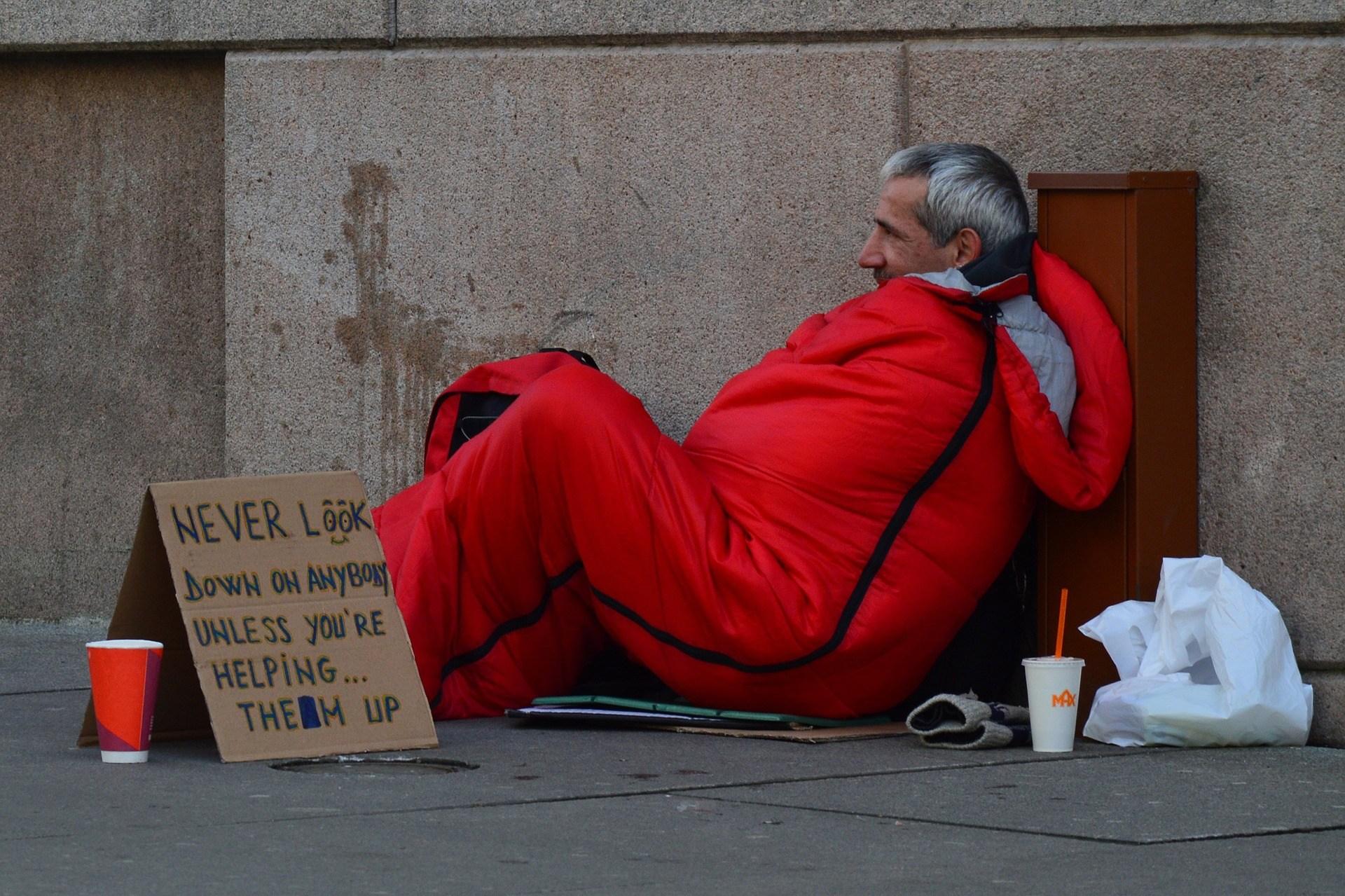 Homeless man in a sleeping bag.
