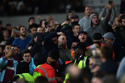 An image of football fans intimidating the opposing fans