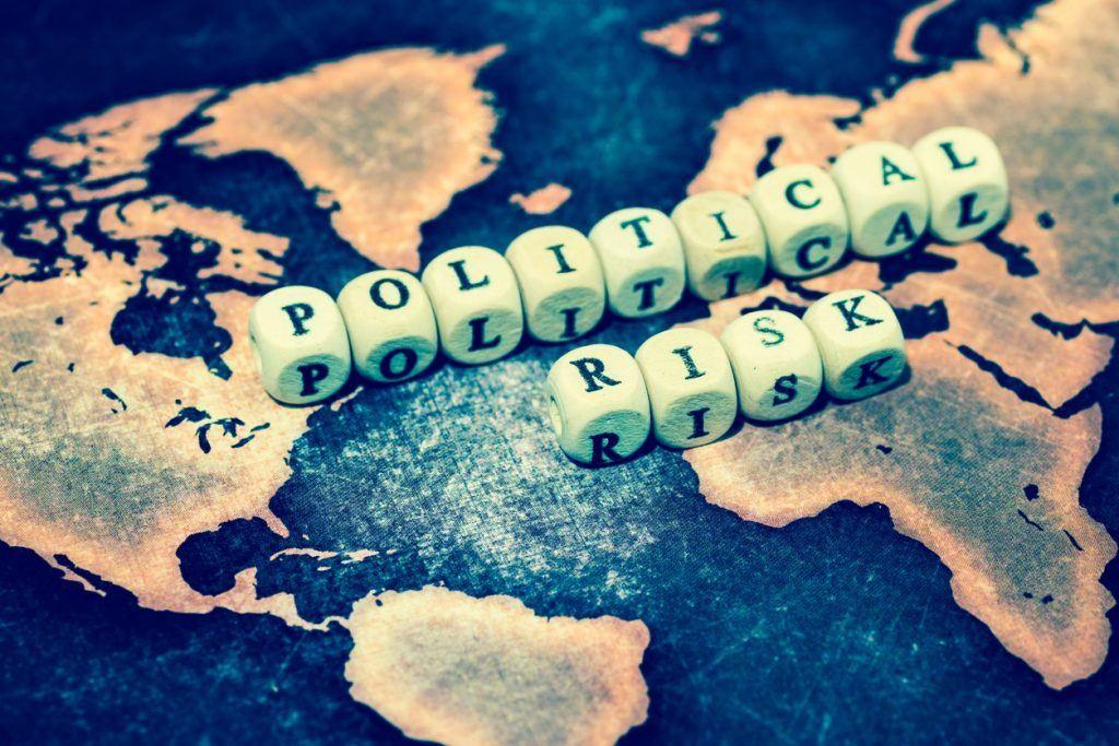 POLITICAL RISK on grunge world map