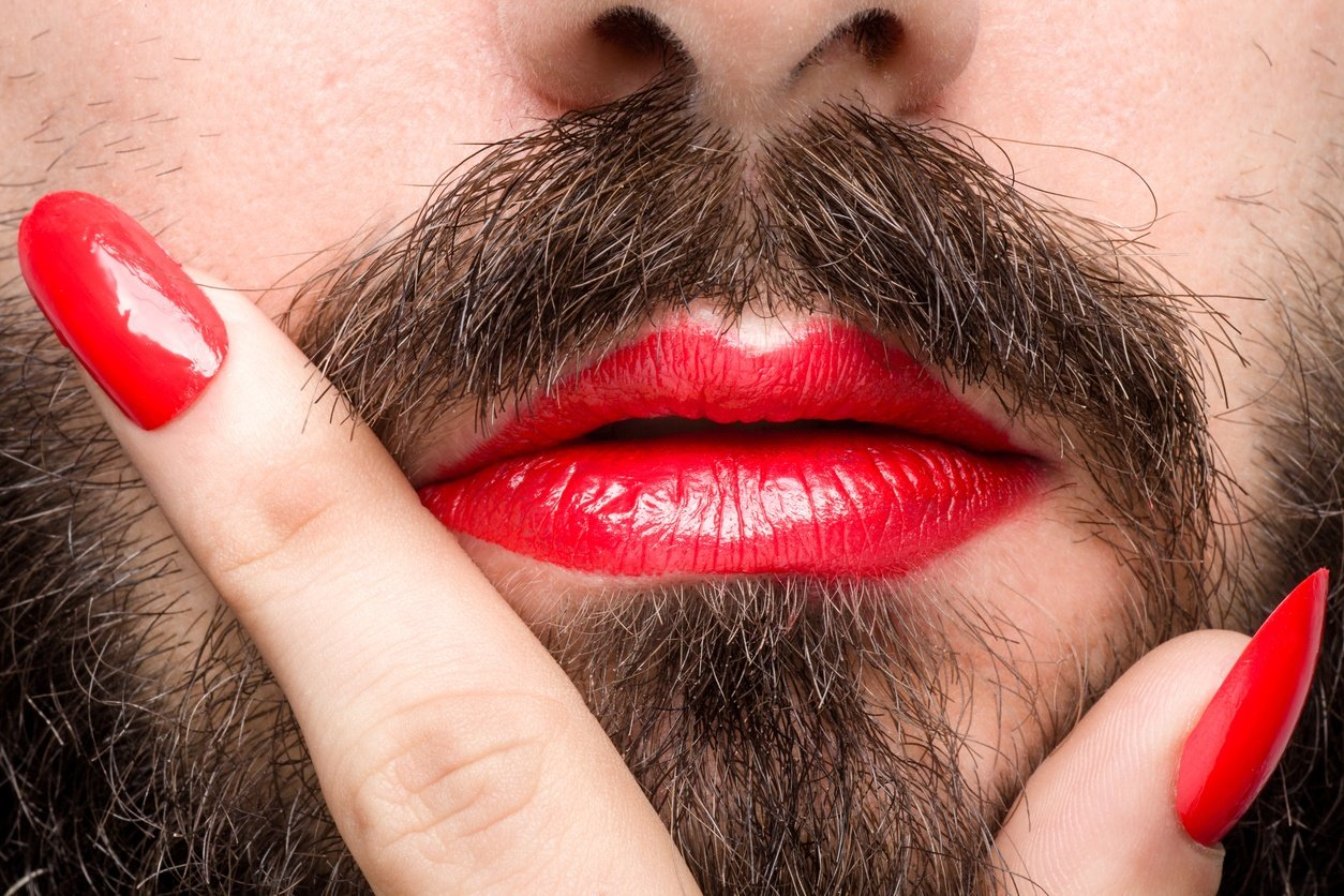 Bearded Man with Red Lipstick on His Lips and Nail Polish
