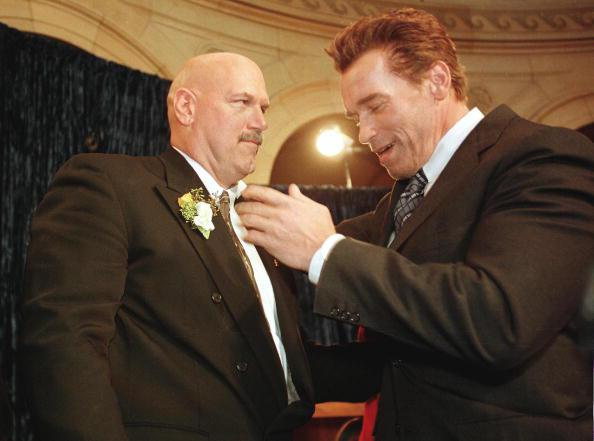 Jesse Ventura and Arnold Schwarzenegger chatting at an event