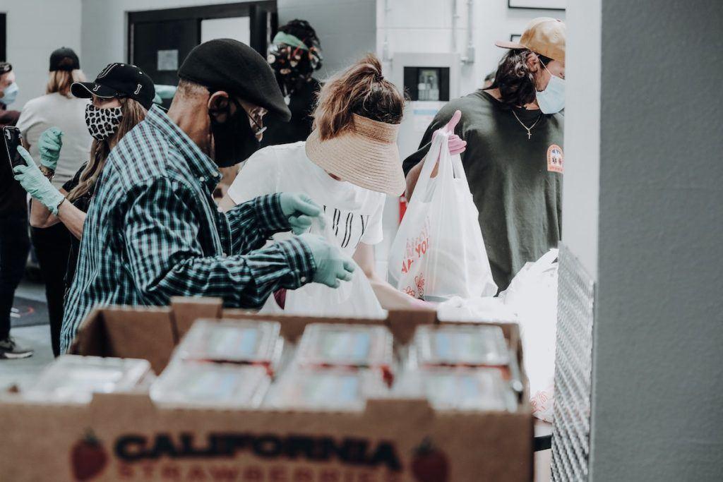 Volunteers giving food support