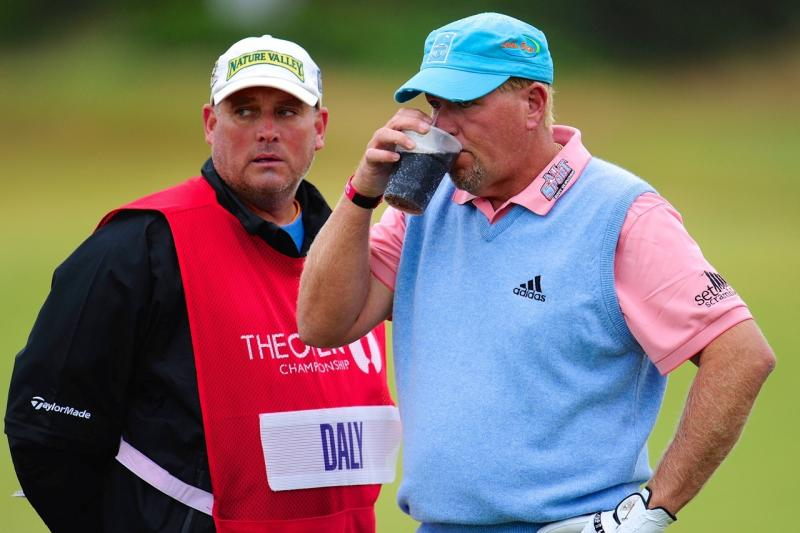 Golfer John Daly drinks coke on the gold course