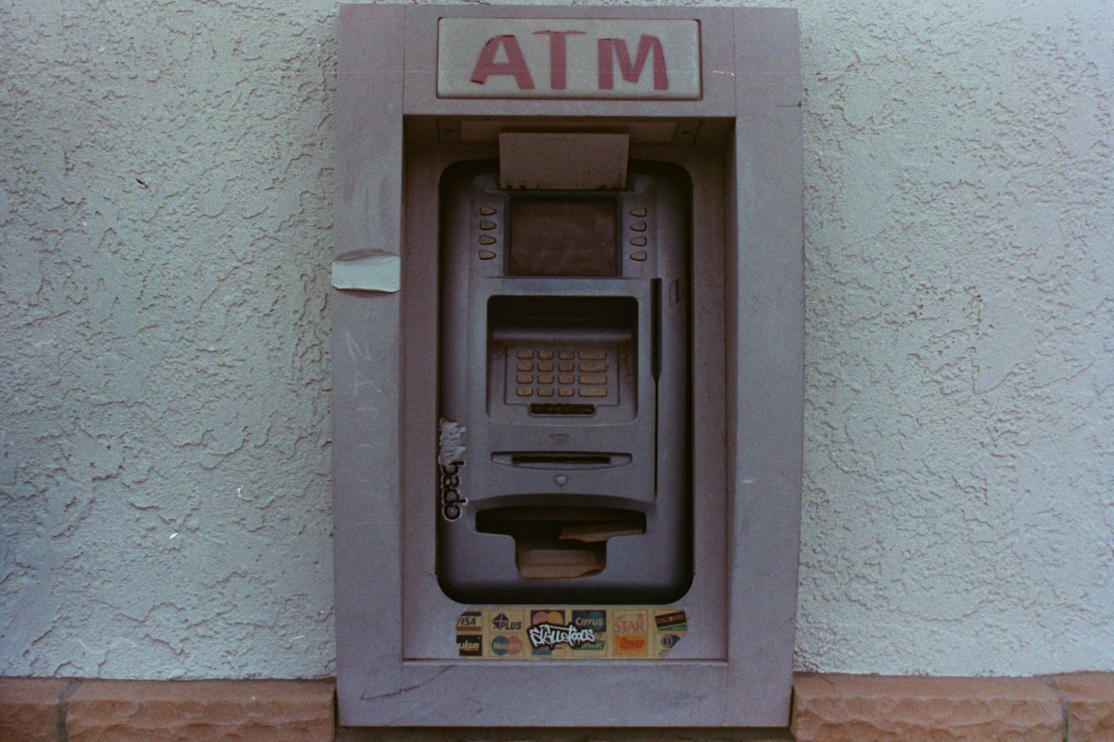 Grey ATM machine.